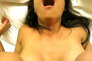 Asian brunette sex together with facial