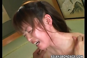 Oriental bitch goes through a inexact bdsm session