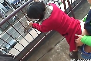 Gorgeous Japanese neonate sucks a constant dick outdoors