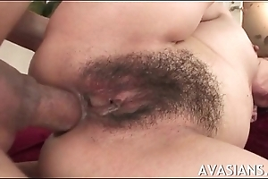 Provocative hairy japanese acquires all of her holes filled