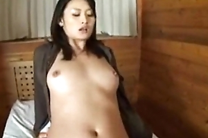 Risa receives creampie while sitting making love