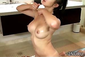 Stunning Eastern masseuse pleases a uncalculated perv all round a Nuru massag-scene-43472-2