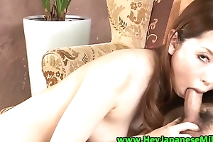 Japanese busty milf in shoes sucks locate on her knees