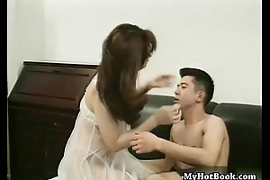 Madoka Sasmine is a cute  Asian shelady who looks