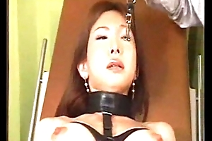Oriental suffers in painful BDSM