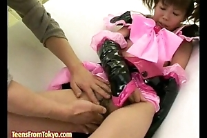 Japanese girl in hero vestment receives fingered