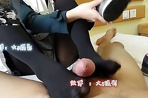 Chinese girl yon blowjob coupled with footjob
