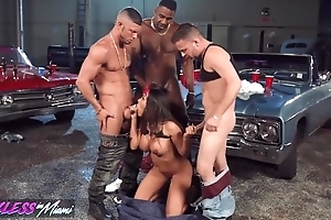 Ugly latin chick pleasuring 3 horny stallions in the garage
