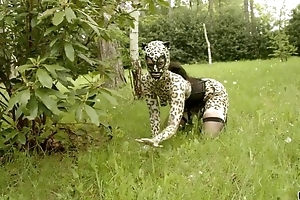 Nasty catwoman adjacent to mask acquires gang group-fucked adjacent to the woods