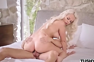 Long-haired belle around natural breasts receives their way backdoor plowed